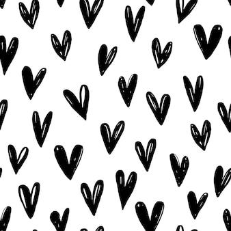 Wzór z ręcznie rysowane grafiki serca.