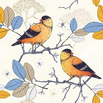 Wzór z ręcznie rysowane tuszem ptaki na kwitnące gałązki drzew. vintage szkic tło z pomarańczowymi ptakami