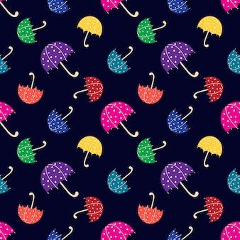 Wzór z słodkie kolorowe parasole na ciemnym niebieskim tle. ilustracja wektorowa