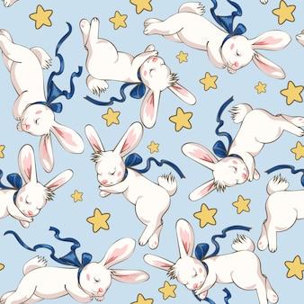Wzór z uroczym śpiącym królikiem i gwiazdami