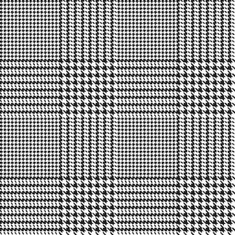 Wzór ząb gończy. nadruk geometryczny w czarno-białym kolorze. pled glen.