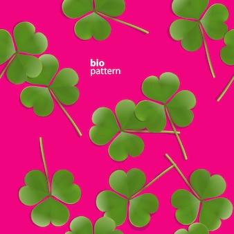 Wzór, zielona koniczyna na różowym tle