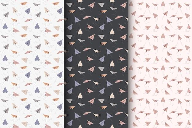 Wzory z ręcznie rysowane papierowe samoloty. symbol podróży i trasy.
