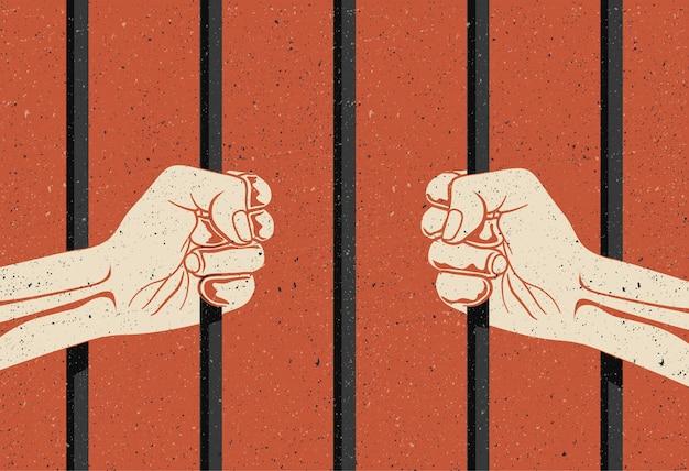 Za kratami. dwie ręce trzymające pręty. więzienie, pojęcie pozbawienia wolności.
