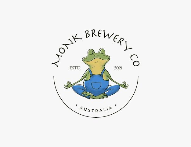 Żaba mnich robi logo firmy piwowarskiej poza jogą