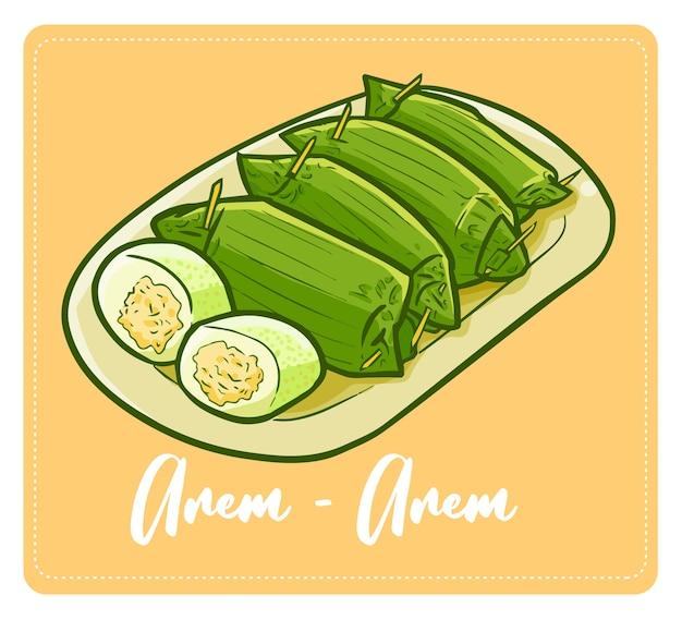 Zabawna i pyszna indonezyjska przekąska arem-arem, czyli gotowany ryż z mięsem z kurczaka w środku, zawinięty w liście bananowca.