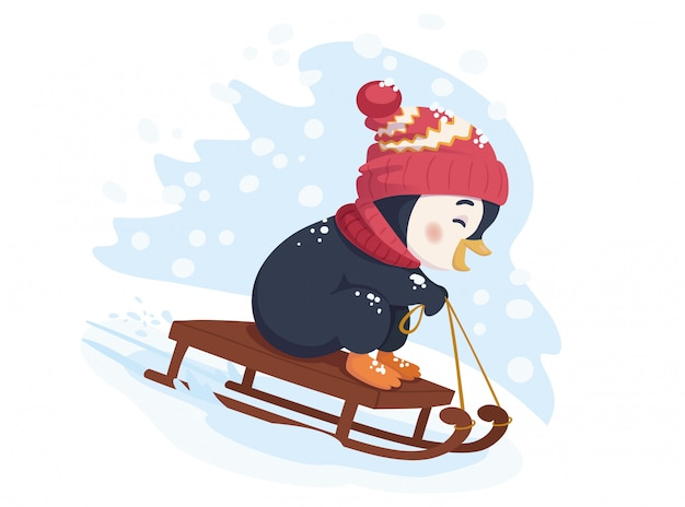 Zabawny pingwin na sankach. saneczkarstwo zimą