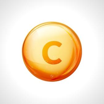Zabieg z witaminą c. witaminowo-złota pigułka olejowa. naturalne odżywianie do pielęgnacji skóry. spadek kwasu askorbinowego przeciwutleniacza. pomarańczowa kapsułka leku.