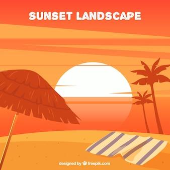 Zachód słońca krajobraz z ręcznikiem i palmy