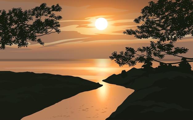 Zachód słońca krajobraz z rzeką w kierunku morza