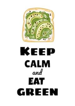 Zachowaj spokój i zjedz zieloną pocztówkę. kanapka z chleba tostowego z awokado i rozłożonym zdrowym plakatem. śniadanie lub obiad wegańskie jedzenie. zdjęcie wydruku wegetariańskiego żywności