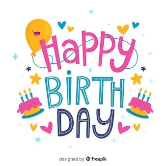 Zadowolony urodziny napis z balonem i ciastem