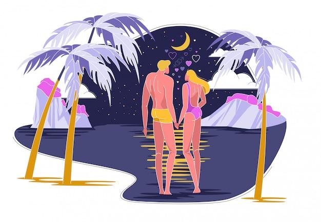 Zakochana para będzie pływać w oceanie w nocy.