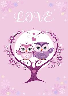 Zakochana para sów siedzi na gałęzi drzewa.