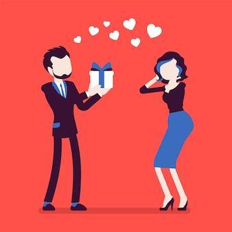 Zakochany mężczyzna, dając prezent dla kobiety