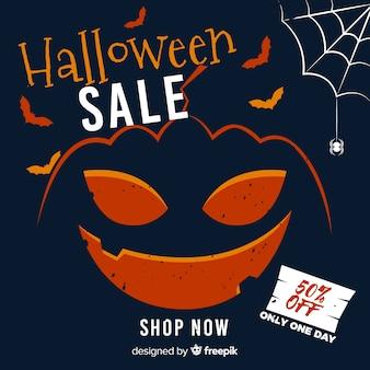 Zakrzywiona dyniowa wyprzedaż halloween z pajęczyną