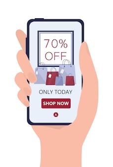 Zakupy online za pomocą urządzeń. marketing mobilny i technologia ppc. dłoń trzymająca smartfona z ogłoszeniem sprzedaży.