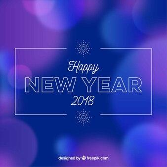 Zamazany nowego roku tło w błękitnym i purpurowym