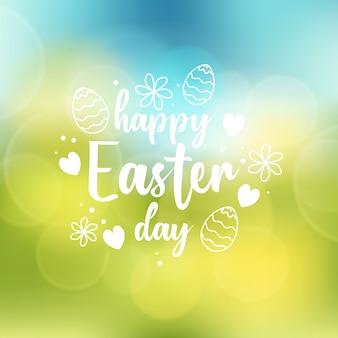 Zamazany szczęśliwy wielkanocny dzień z kwiatami i jajkami