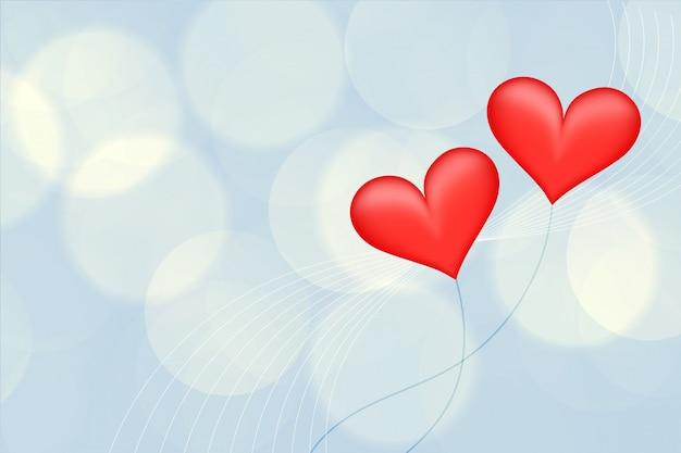 Zamazany tło z dwa czerwonymi balonowymi sercami