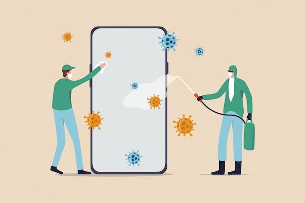Zapobieganie koronawirusom czyści telefon, dezynfekuje smartfon i dezynfekuje covid-19 koncepcja koronawirusa, pracownik służby zdrowia i sprzątania z pełnym wyposażeniem ochronnym dezynfekuje i dezynfekuje telefon.