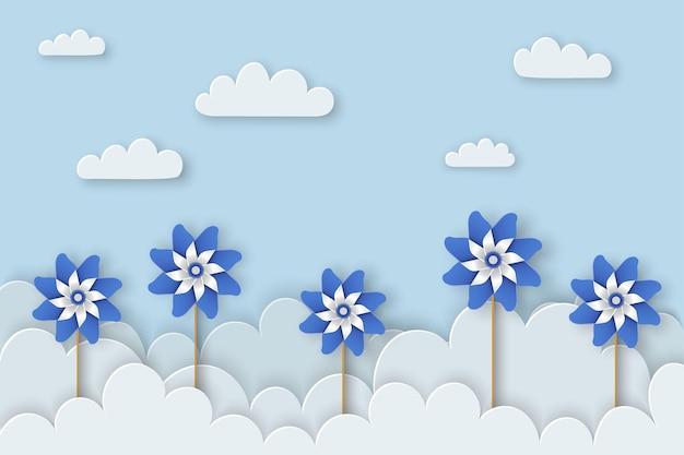 Zapobieganie krzywdzeniu dzieci miesiąc kwiecień tło świadomości krzywdzenia dzieci plakat z niebieskimi wiatraczkami