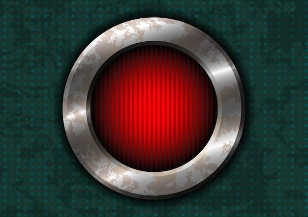 Zardzewiały metalowy okrąg z czerwoną lampką