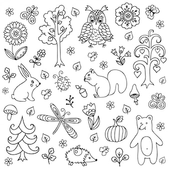 Zarys dekoracyjne elementy ręcznie rysowane w dziecinnym stylu bazgroły - zwierzęta i owady, drzewa i rośliny.