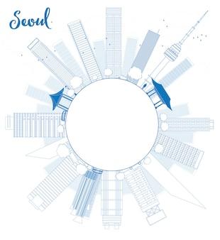 Zarys seul panoramę z niebieskim budynku i przestrzeni kopii