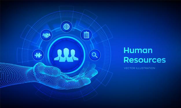 Zasoby ludzkie. symbol hr w robotycznej dłoni. ludzka sieć społeczna i przywództwo.