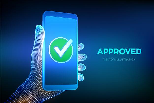 Zatwierdzony. znacznik wyboru ręka trzyma smartfon z zieloną ikoną znacznika wyboru na ekranie.