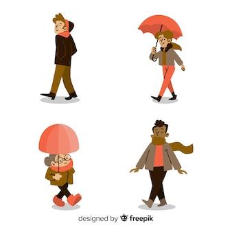 Zbiór ludzi chodzących jesienią