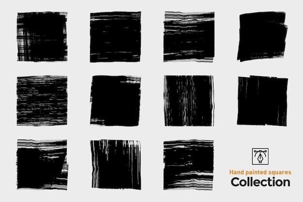 Zbiór pojedynczych pociągnięć pędzla. czarne ręcznie malowane pociągnięcia pędzlem. atramentowe kwadraty grunge.