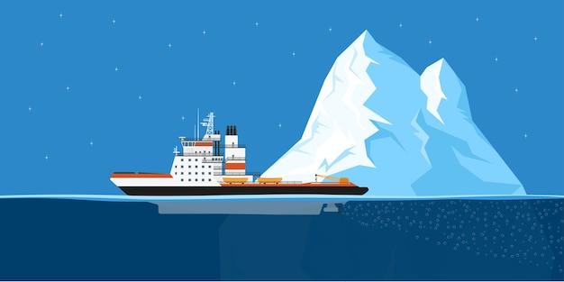 Zdjęcie statku lodołamacza diesla i góry lodowej,