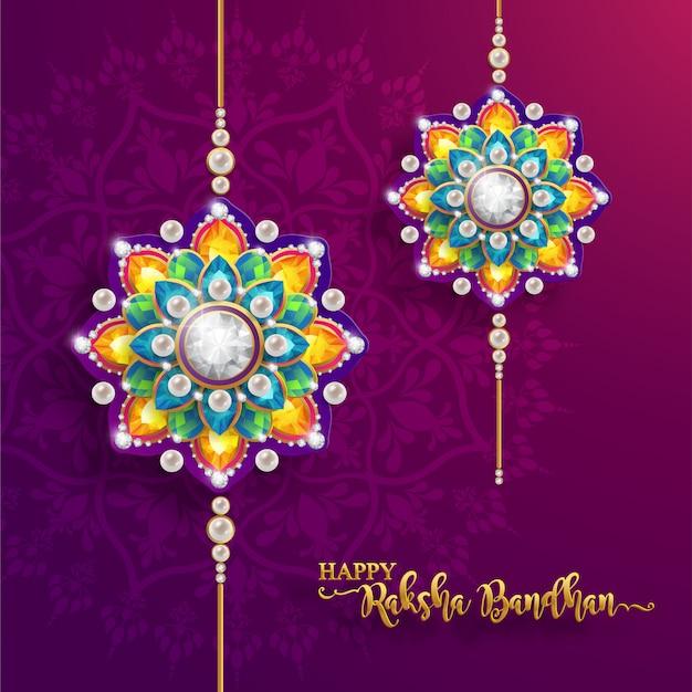 Zdobione rakhi na indyjski festiwal raksha bandhan greeting card, indyjski festiwal ze złotem i kryształami na papierze w kolorze tła.
