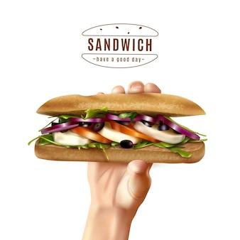 Zdrowa kanapka w ręku realistyczny obraz