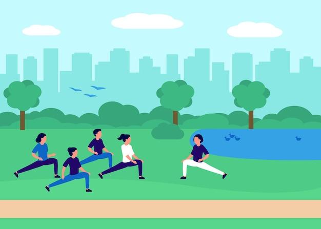 Zdrowi ludzie robią jogę, sport w miejskim parku miejskim. grupa ludzi razem ćwiczących w przyrodzie. krajobraz miejski, teren rekreacyjny z mężczyznami i kobietami w zajęciach jogi robi ćwiczenia na świeżym powietrzu.