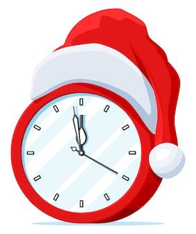 Zegary ubrane w czapkę świętego mikołaja. zegar wskazujący prawie północ z czerwoną czapką. szczęśliwego nowego roku ozdoba. wesołych świąt bożego narodzenia. obchody nowego roku i bożego narodzenia. płaska ilustracja wektorowa