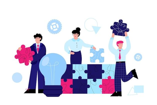Zespół biznesowy łączący koncepcję pracy zespołowej puzzli