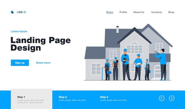 Zespół budowniczych pozuje do zdjęcia przed domem. pracownik, kask, kamera płaska ilustracja. koncepcja budowlana lub architektoniczna projekt strony internetowej lub strona docelowa