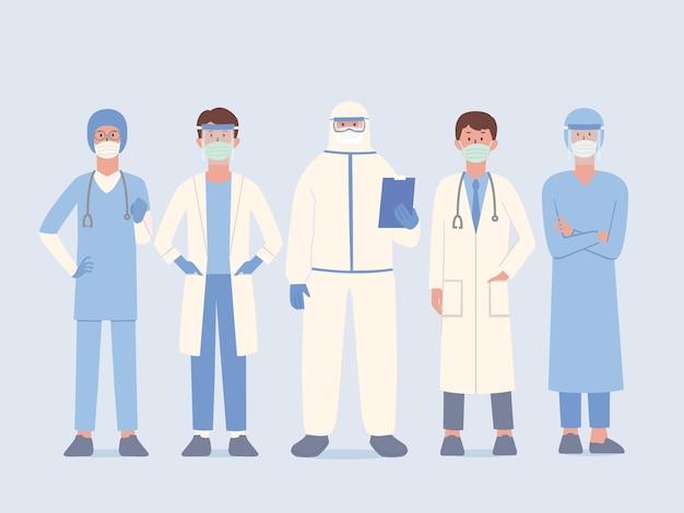 Zespół lekarski w mundurze i masce chirurgicznej oraz osłonie twarzy i kombinezonie ppe w gotowości do pomocy pacjent i praca w pozycji stojącej. personel przygotowuje się do ochrony ludzi przed wirusami i chorobami. postać z kreskówki.