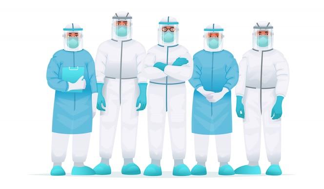 Zespół lekarzy w kombinezonie ochronnym, masce medycznej i okularach. Zwalczanie wybuchu epidemii koronawirusa COVID-2019