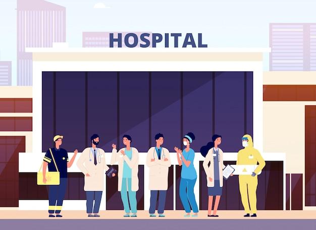 Zespół medyczny. budynek szpitala, profesjonalna pielęgniarka i lekarze. personel medyczny w mundurze. ilustracja kreskówka lekarzy