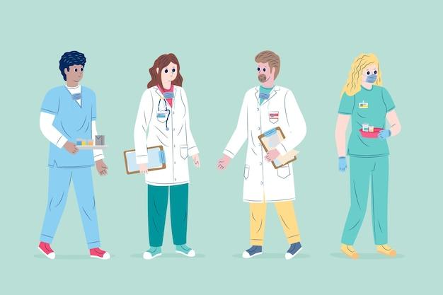 Zespół pracowników służby zdrowia z maską