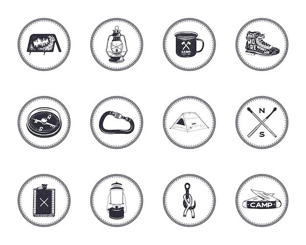 Zestaw 12 ikon sylwetka camping i symbole