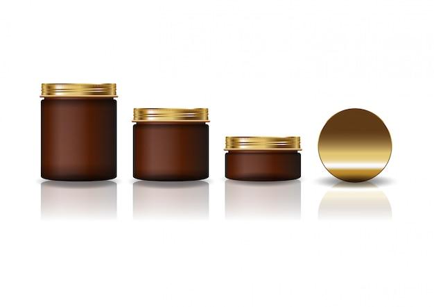 Zestaw 3 rozmiarów brązowego okrągłego słoika kosmetycznego ze złotą pokrywką dla urody lub zdrowego produktu.