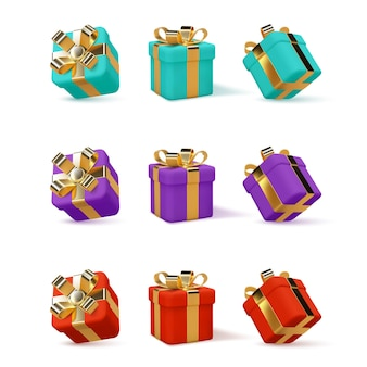 Zestaw 3d pudełek prezentowych owiniętych złotą wstążką na białym tle