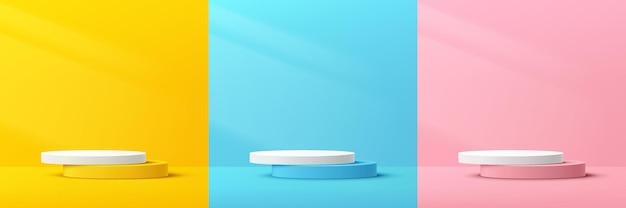 Zestaw abstrakcyjnego 3d pastelowego żółtego, różowego, niebieskiego i białego podium na cokole z oświetleniem