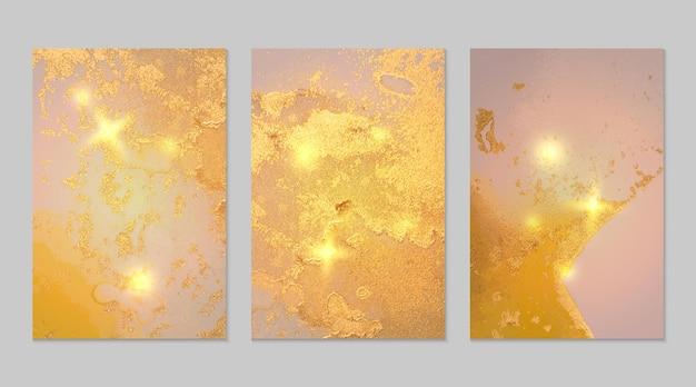 Zestaw abstrakcyjnych żółtych, różowych i złotych tła z marmurową teksturą i błyszczącym brokatem