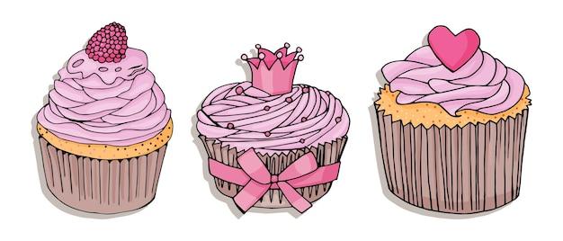 Zestaw babeczek. babeczka z różowym kremem i różowym sercem; babeczka z koroną i różową kokardką; czekoladowa babeczka z różowym kremem i malinami na białym tle